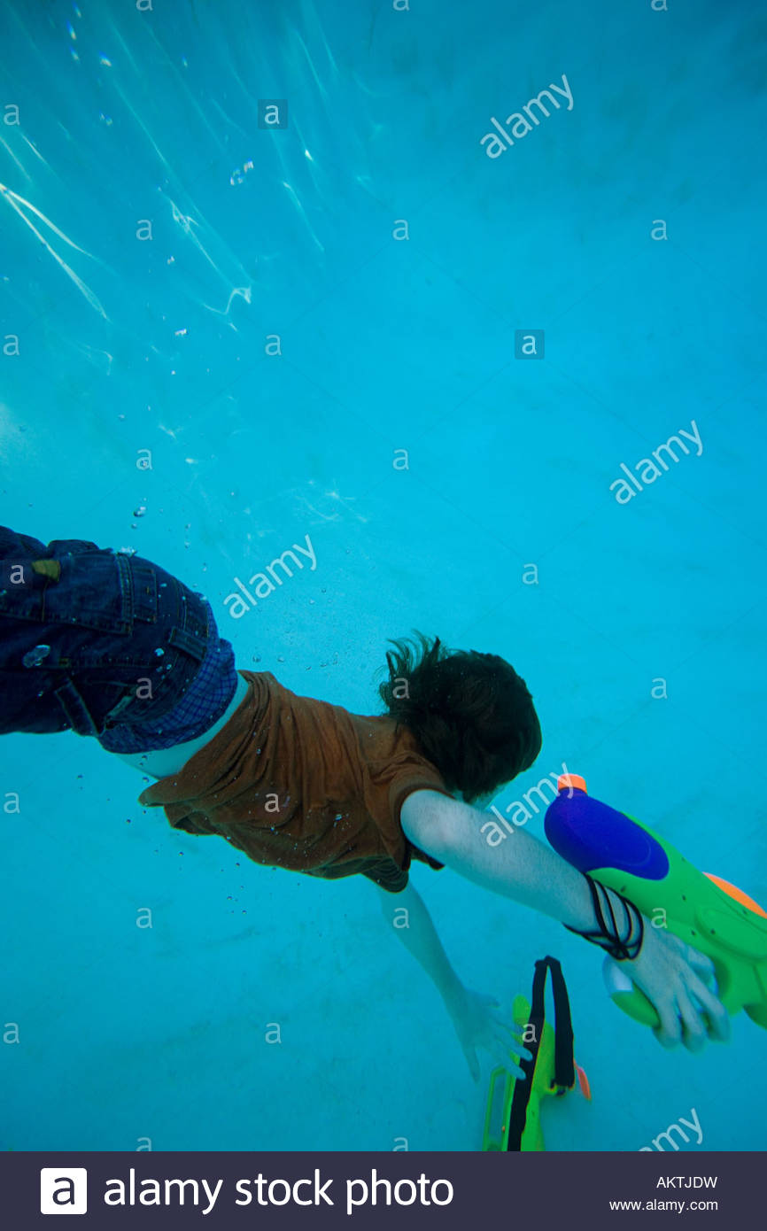 Boys swimming under water - Stock Image