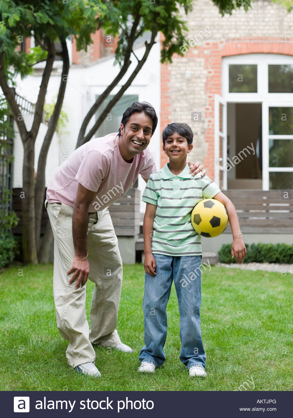 Father and son with football - Stock Image