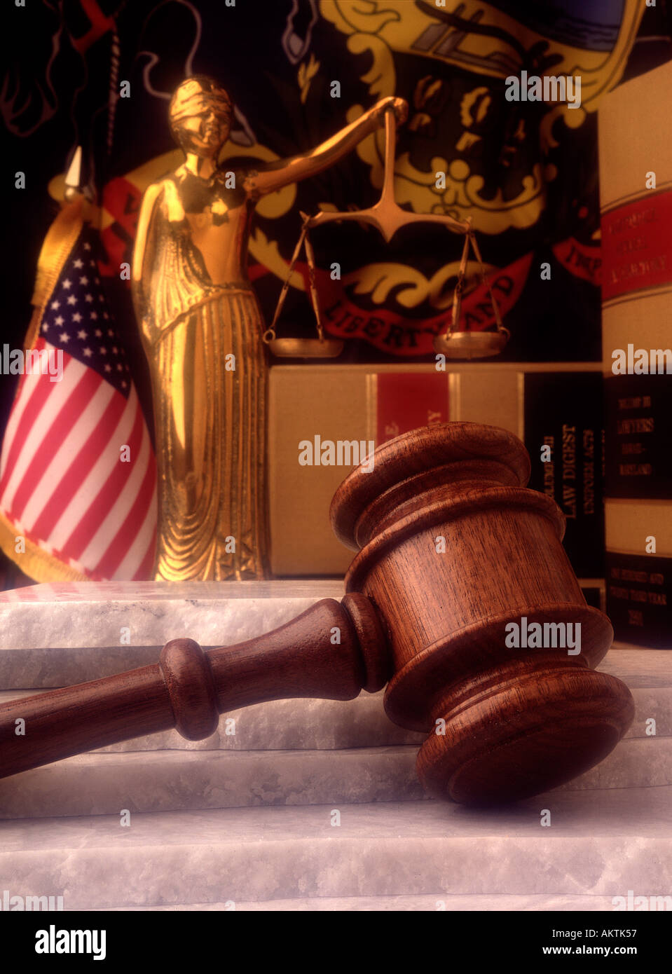still life statue lady justice law books judges gavel marble stone base american US flag PA Pennsylvania state flag democracy - Stock Image