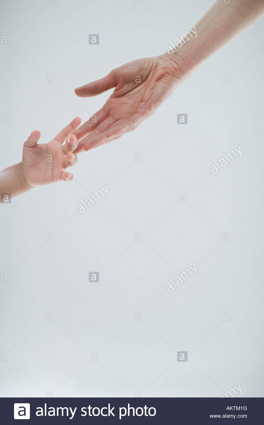 Hands of adult and child - Stock Image