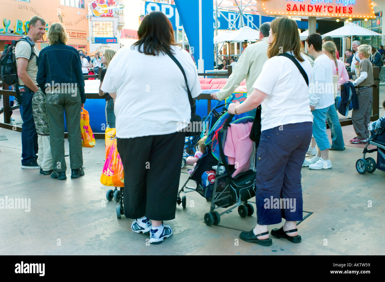 Paris FRANCE, Amusement Parks 'Disneyland Paris' Overweight Mothers in 'Disney Village' Walking away with Baby Carriages - Stock Image