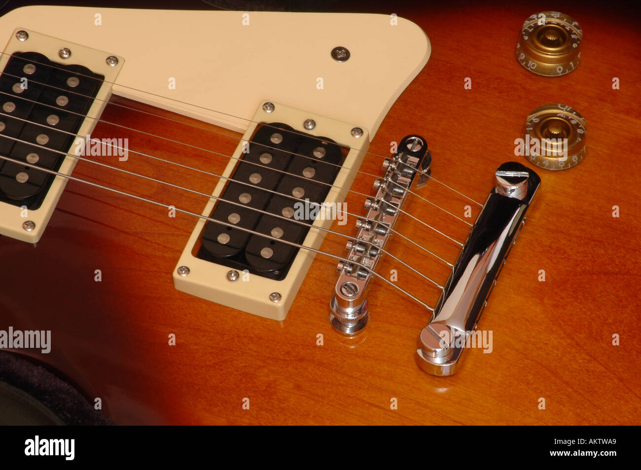 Close Up View Of Pick Ups And Bridge From A Gibson Epiphone Les Paul