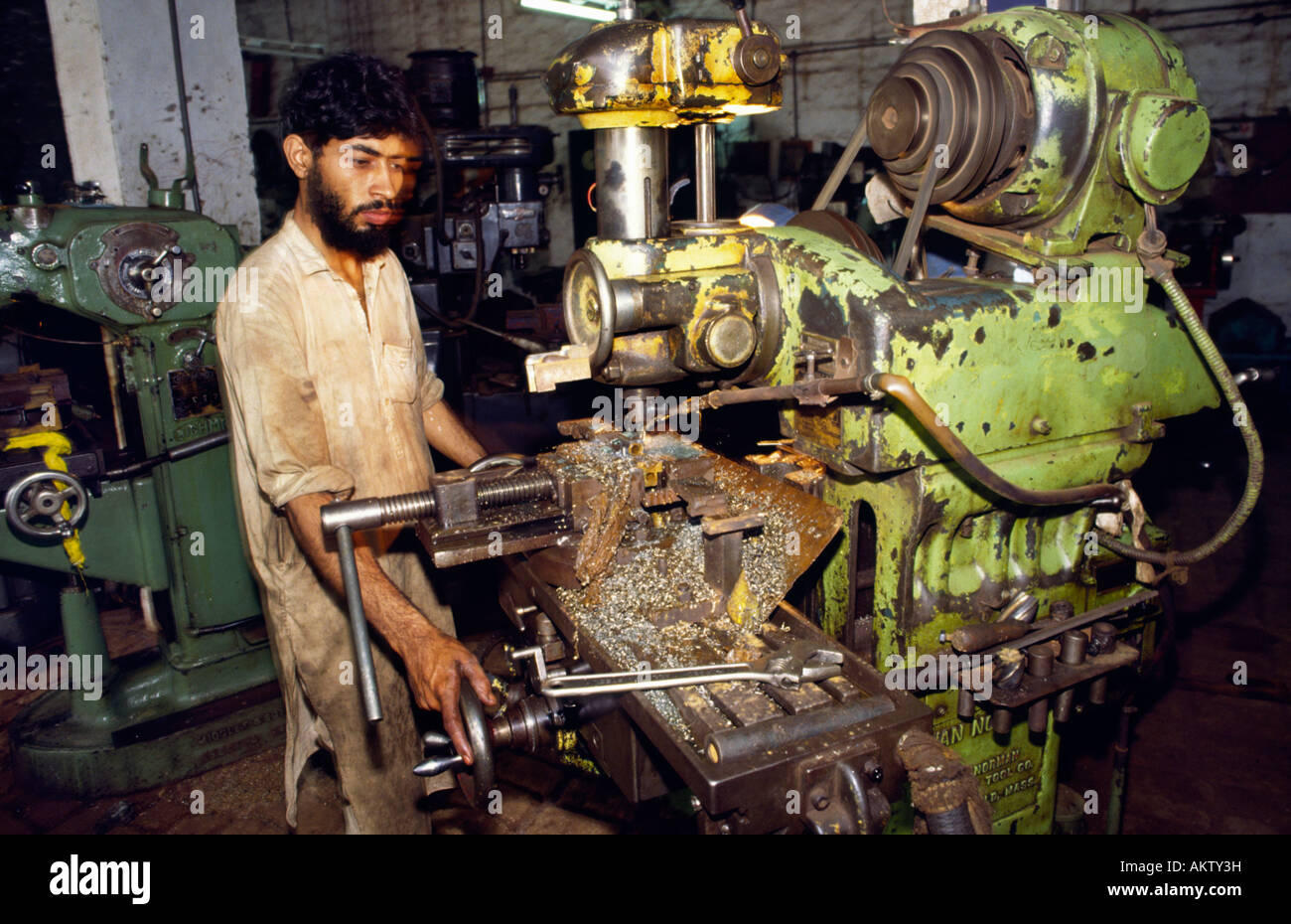 Worker in factory producing AK-47 copies. Darra, North Western Frontier Province, Pakistan. - Stock Image