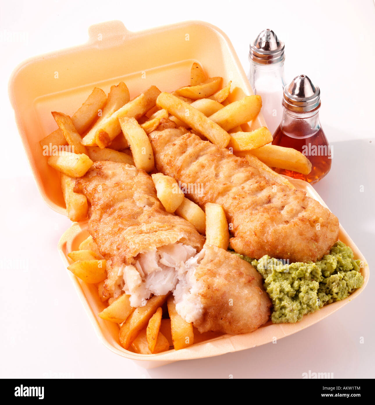 TAKEAWAY FISH AND CHIPS WITH MUSHY PEAS - Stock Image