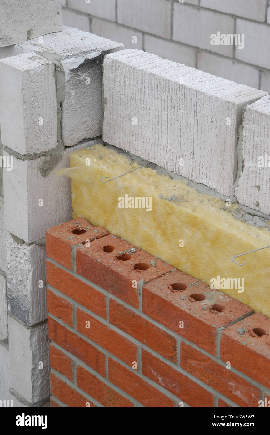 Marvelous Part Of A New House Under Construction Showing The Layers Of Breeze Block,  Insulation And Bricks
