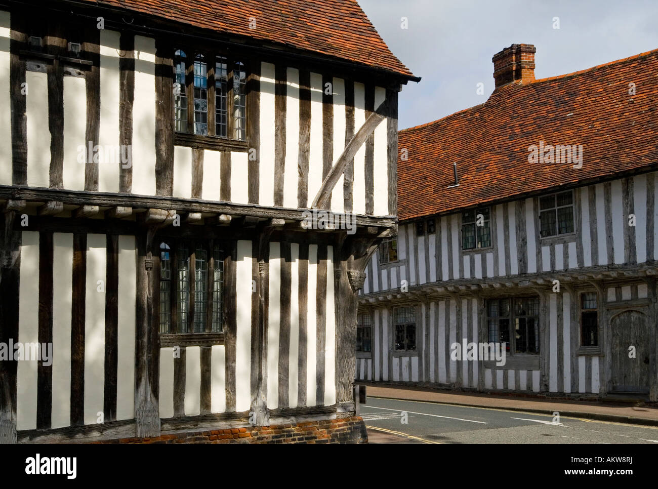 Half timbered traditional buildings in historic Lavenham Village Suffolk England UK with typical vernacular architecture - Stock Image