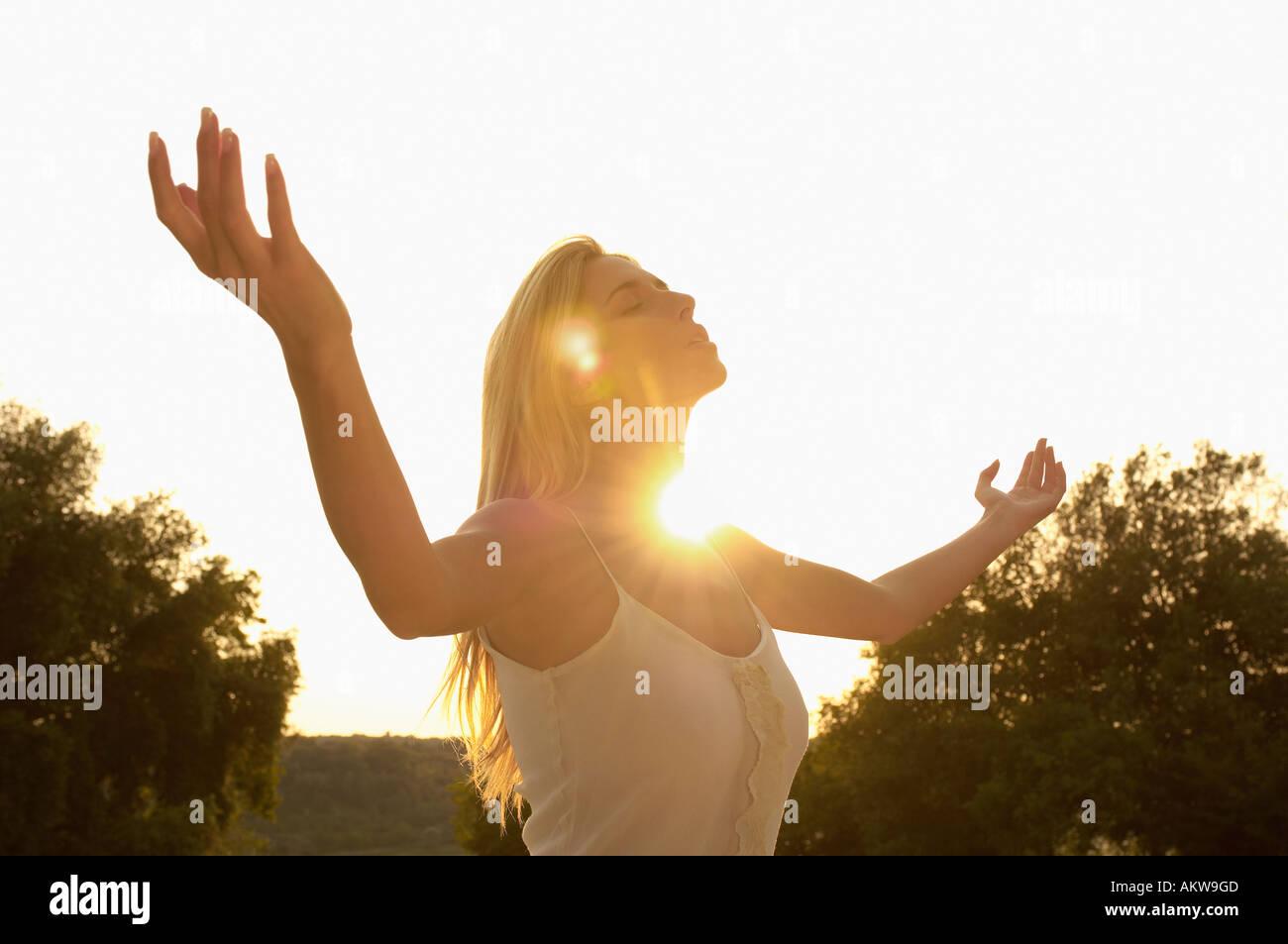 Young woman practising yoga, portrait - Stock Image