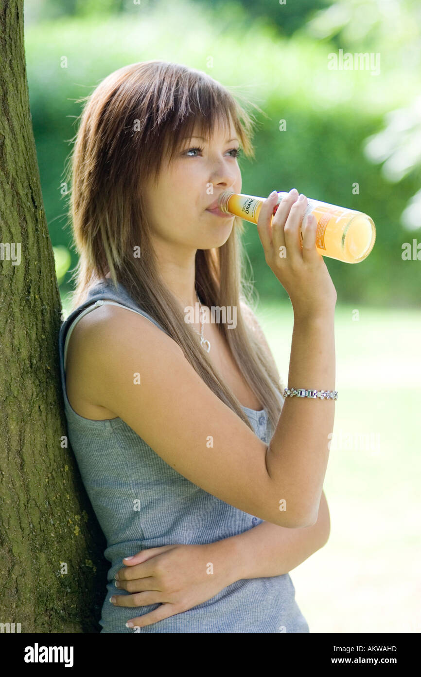 a teenage girl drinking an alcoholic drink - Stock Image