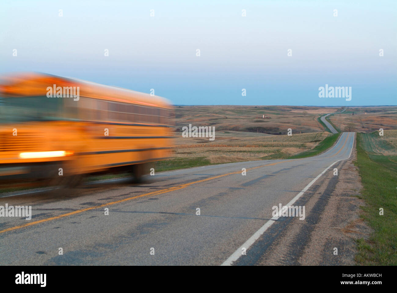 New Town school bus along highway 23 on the Fort Berthold Indian Reservation in North Dakota - Stock Image