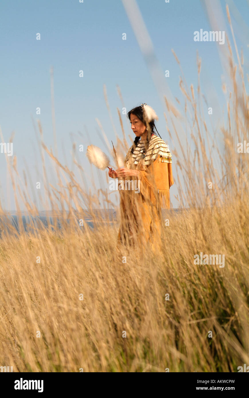 Amy Mossett dressed in a 19th century style dress along the Missouri River on the Fort Berthhold Indian Reservation - Stock Image