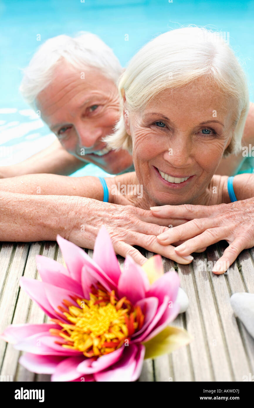 Germany, Senior couple in pool, close-up - Stock Image