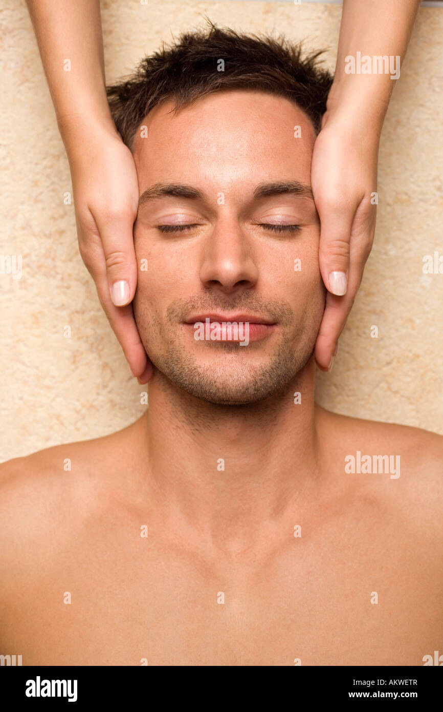 Germany, man receiving facial massage, close-up - Stock Image