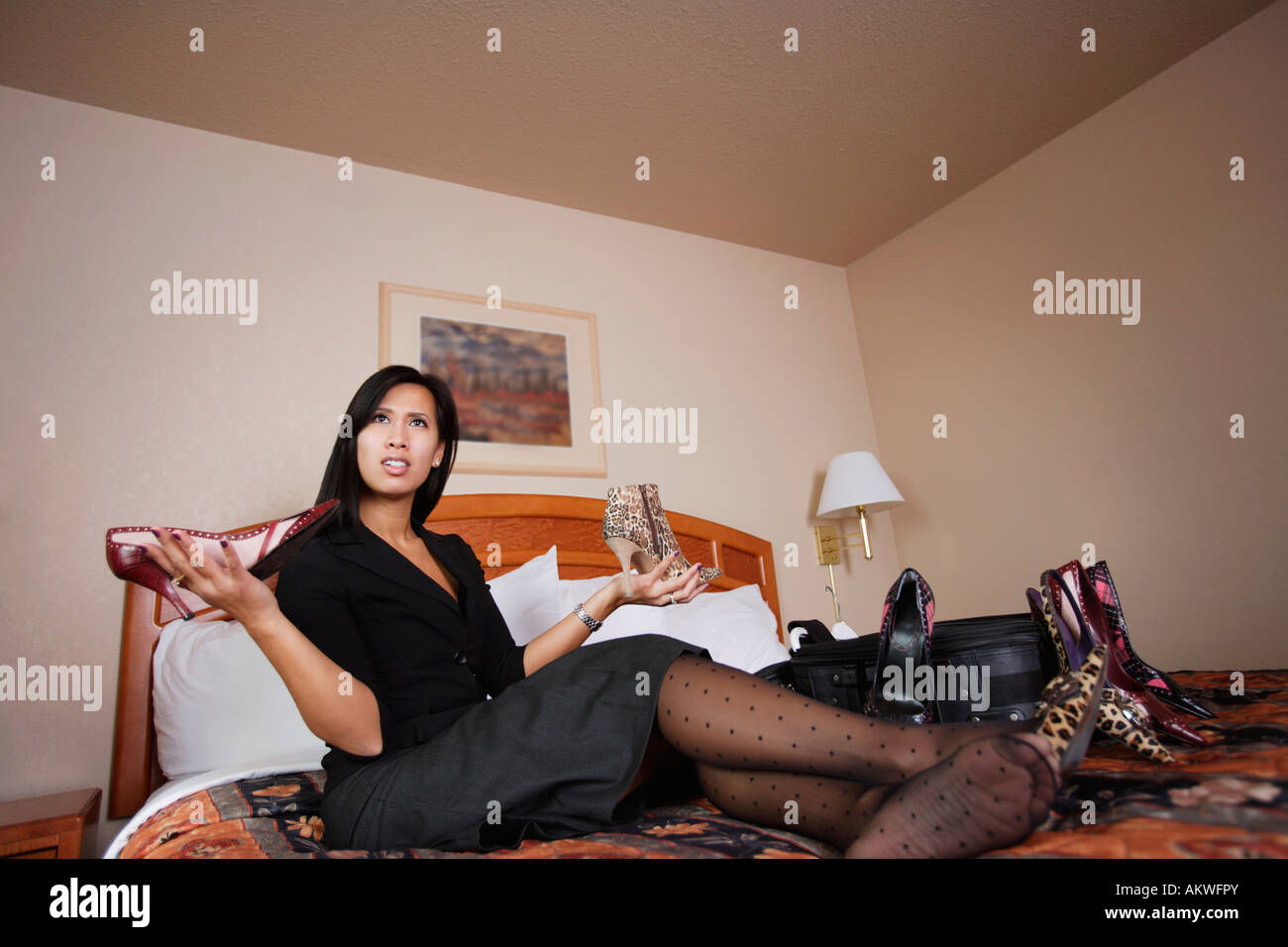 A woman comparing shoes Stock Photo