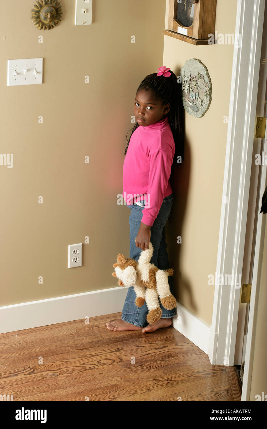 Standing In The Corner : Girl standing in the corner stock photo alamy
