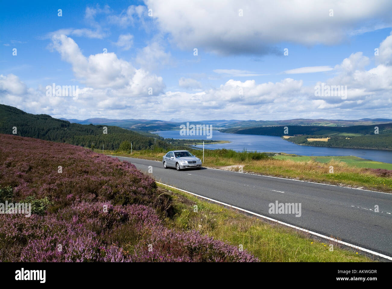 dh Struie Hill STRUIE ROSS CROMARTY Car driving scotland scottish country road highlands drive scenic summer uk touring view holiday countryside Stock Photo