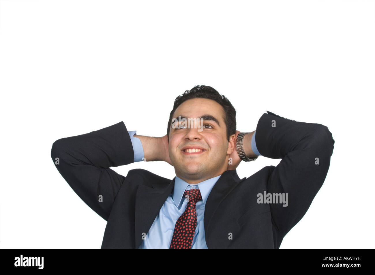 business man resting hands behind head - Stock Image