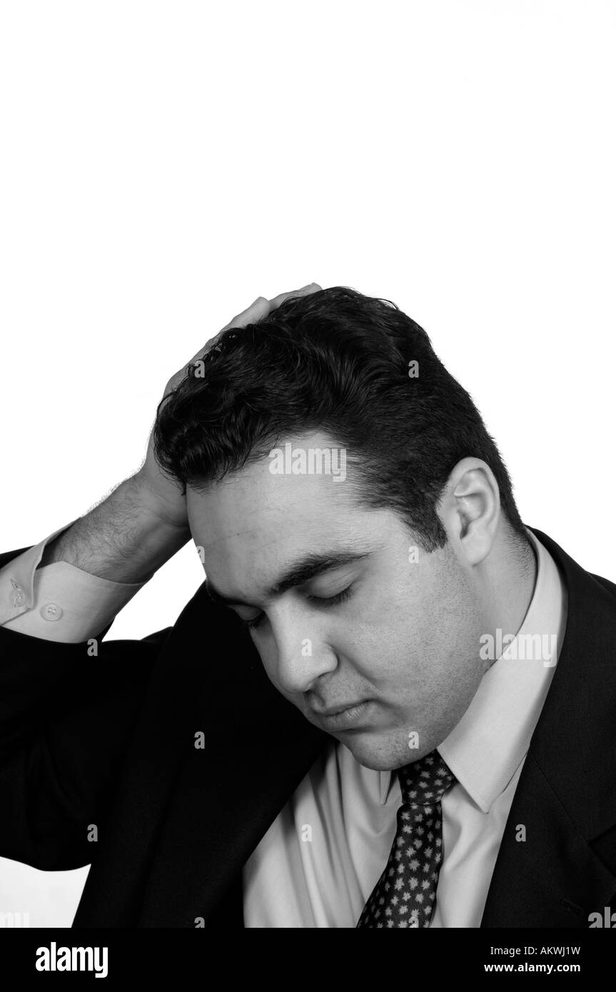 stressed businessman hand on head - Stock Image