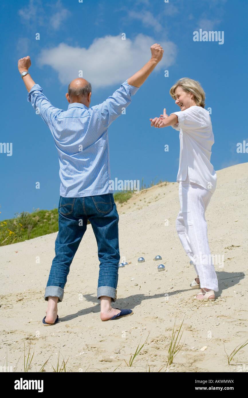 Mature couple playing boccia - Stock Image