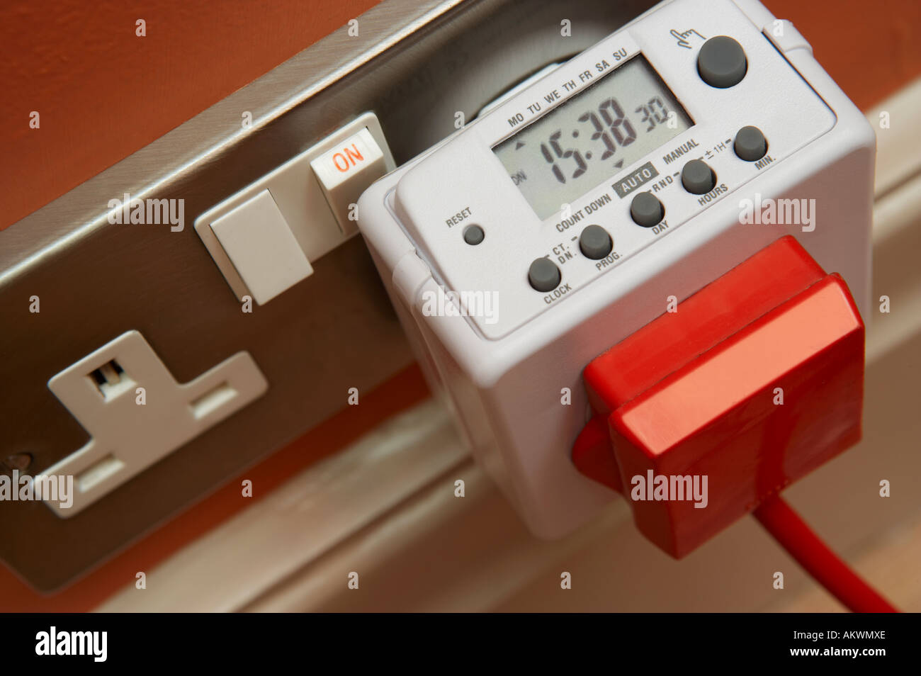 DIGITAL ELECTRONIC TIMER FOR ELECTRICAL APPLIANCES PLUGGED INTO 13 AMP MAINS SOCKET Stock Photo