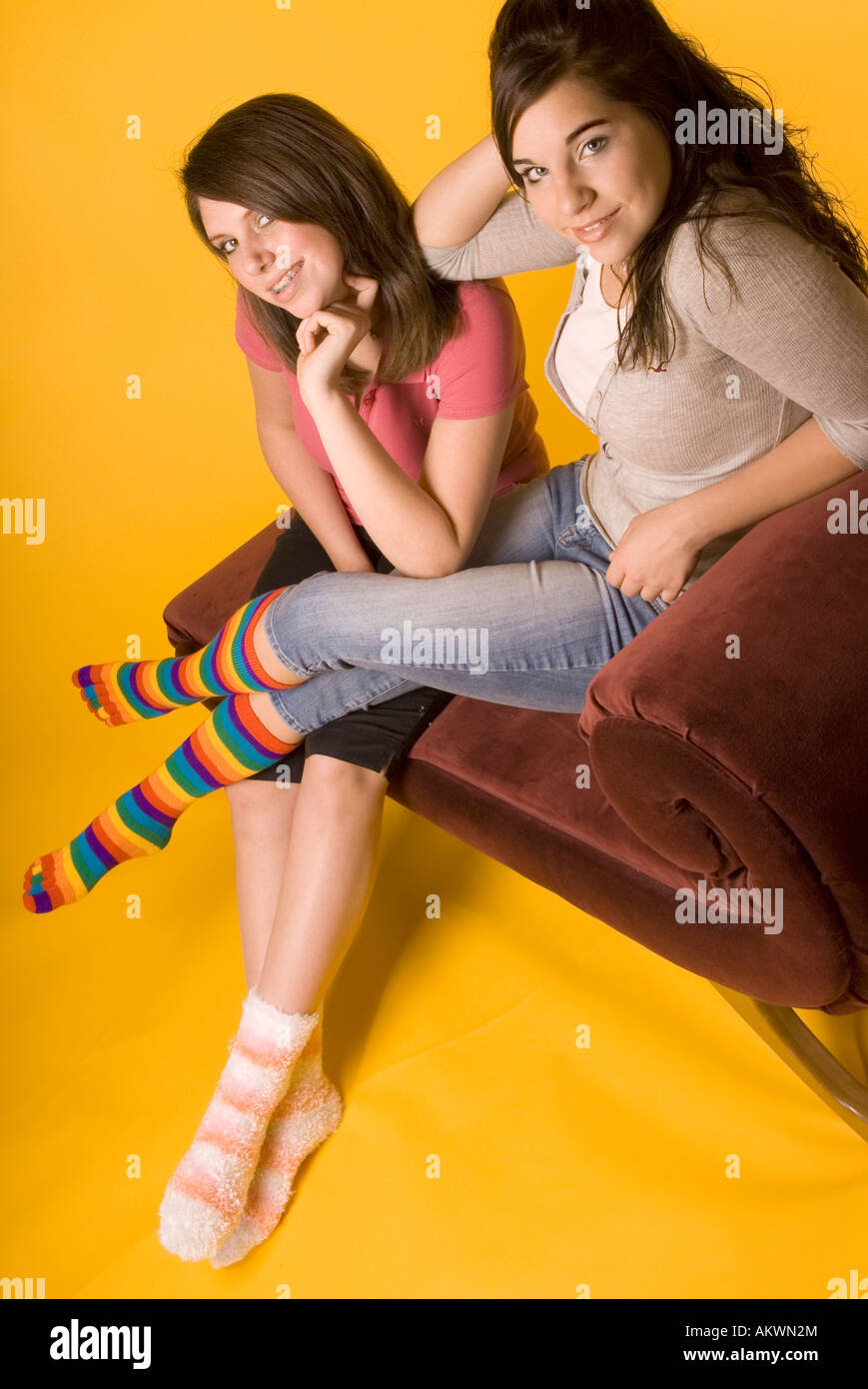 Two Teen Girls (15-17) Wearing Colorful Mismatched Socks