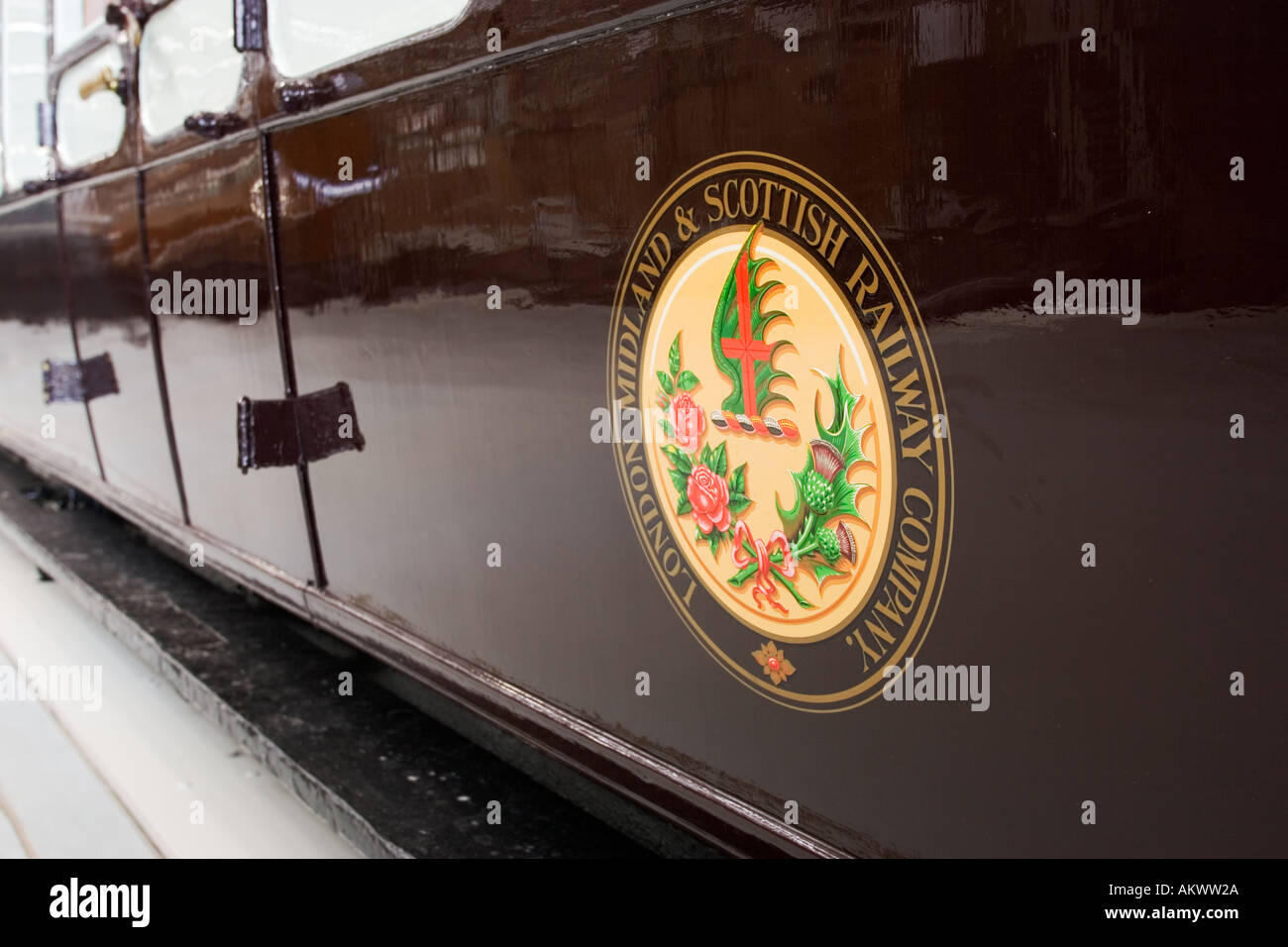 London Midland Scottish LMS Railway insignia on a brown carriage - Stock Image