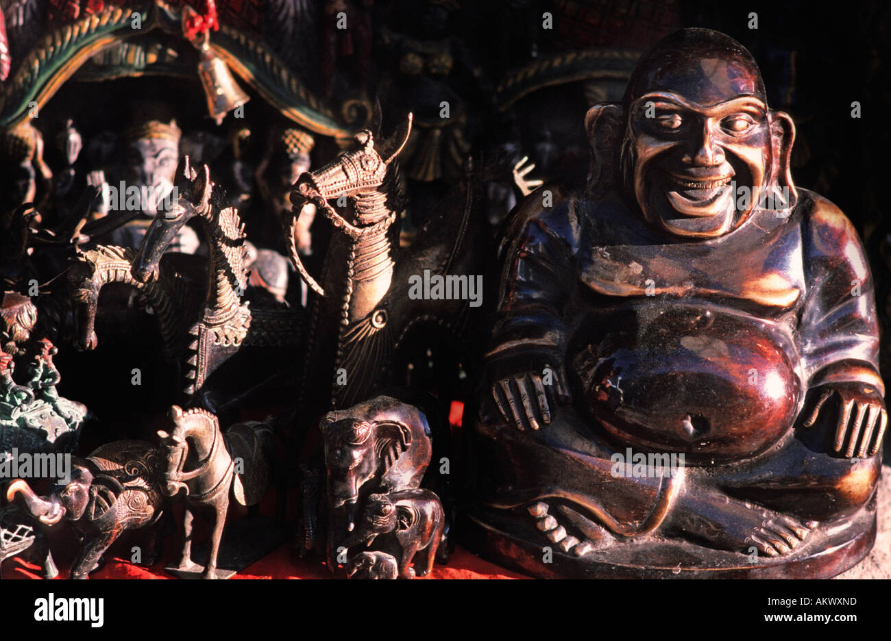 A selection of hindu and buddhist sculptures in brass and bronze offered to tourists on a market stall Leh Ladakh India - Stock Image
