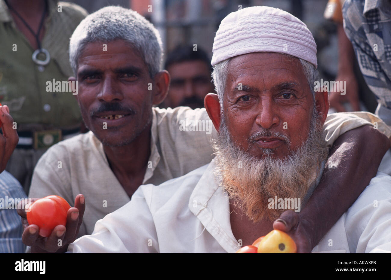 Indian men at the vegetable market Agra India - Stock Image