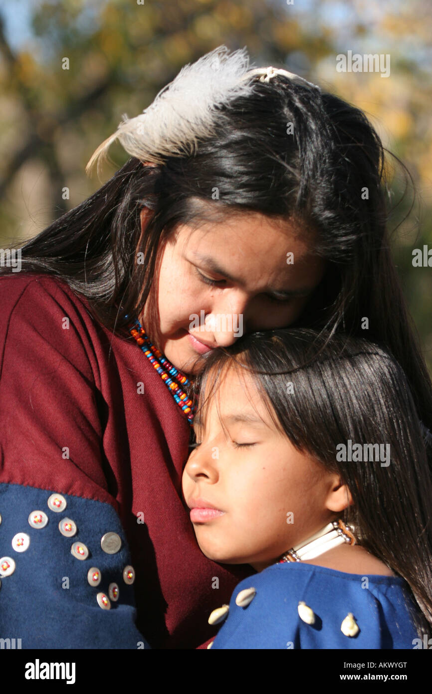A Native American Indian mother hugging her child - Stock Image