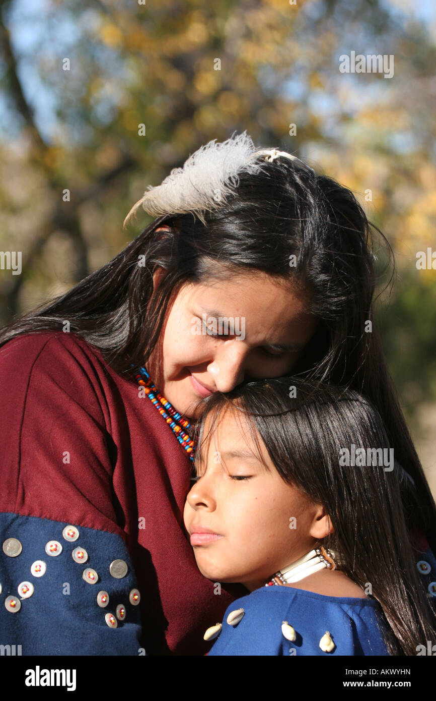 A Native American Indian woman hugging a child - Stock Image