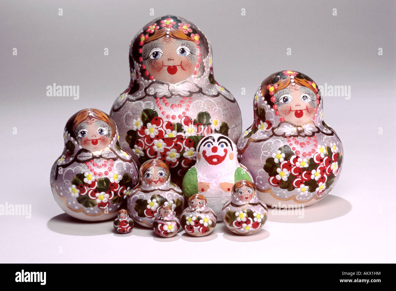 Russian Dolls with a Deviant. Grouping, white background. - Stock Image