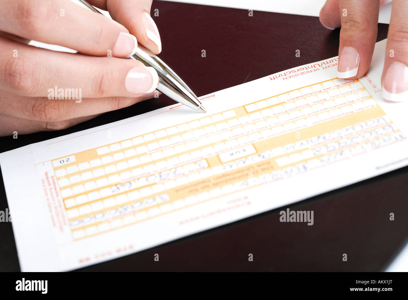 person filling in a money transfer form stock image