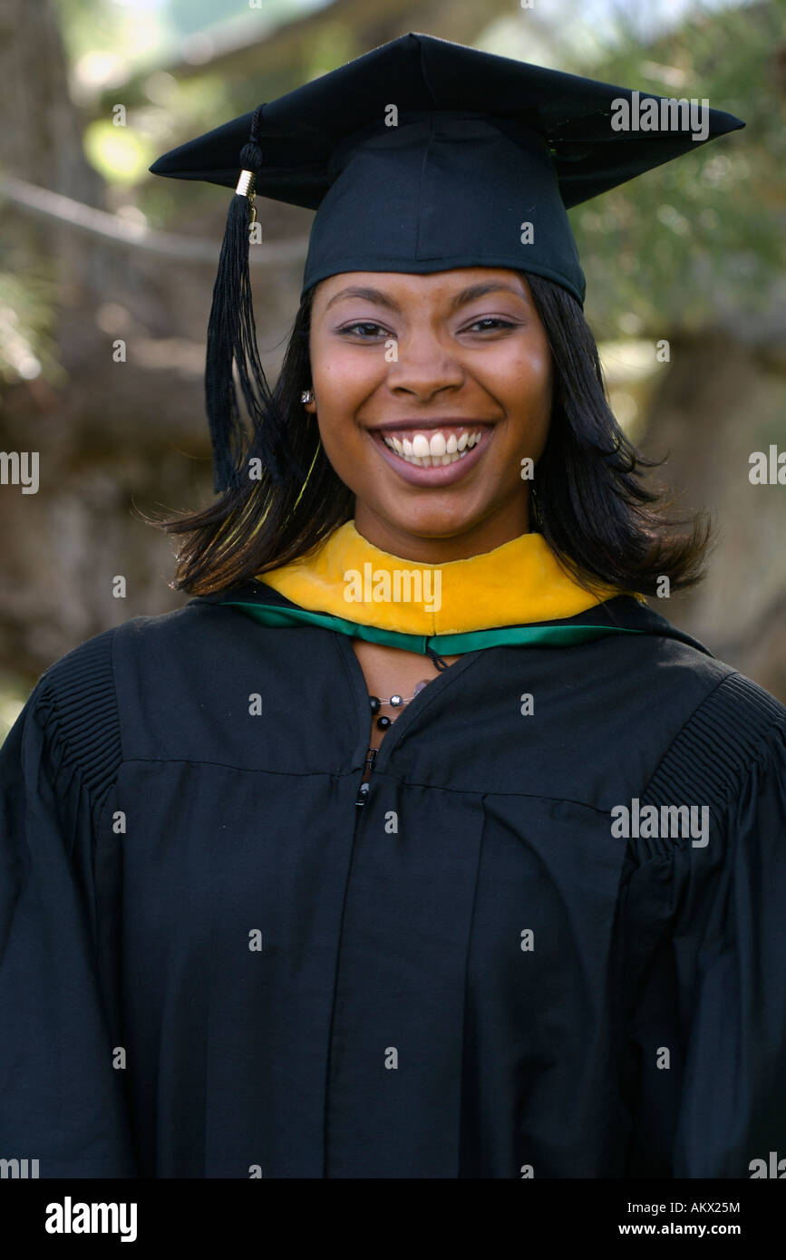 African American woman wearing a graduation cap gown and hood Stock ...