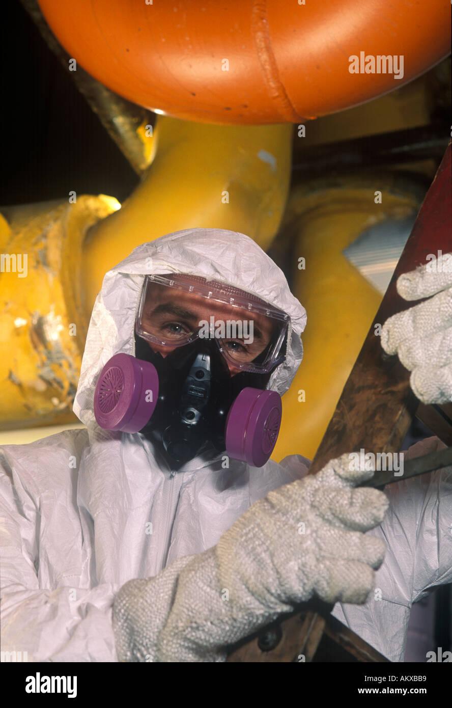 Hazardous material worker in factory. - Stock Image
