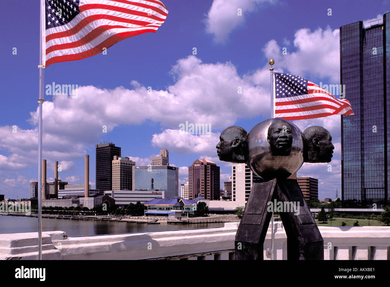 Rev Martin Luther King sculpture on the Martin Luther King Memorial Bridge over the Maumee River skyline of Toledo Ohio - Stock Image