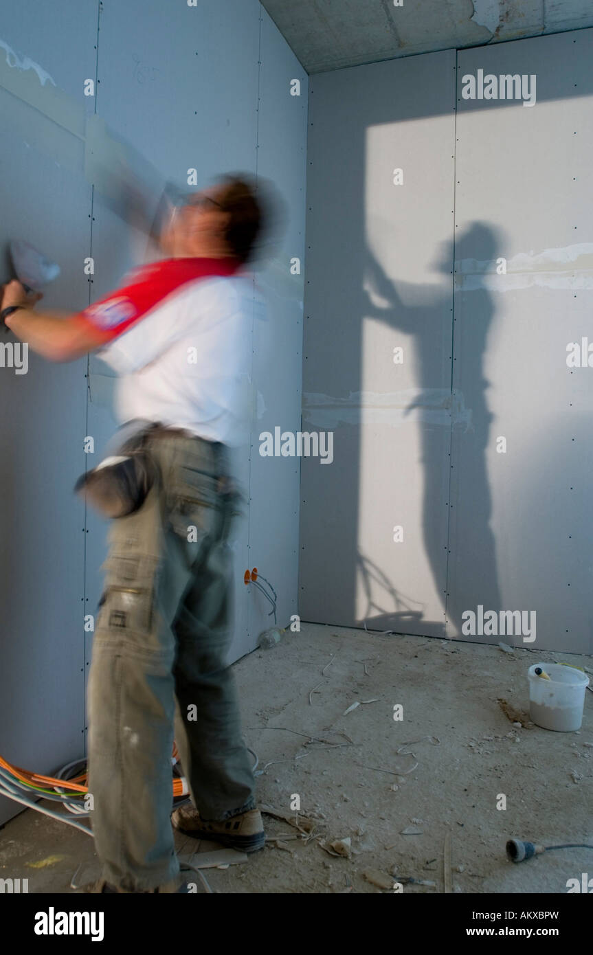 Construction worker inside an house shell Stock Photo