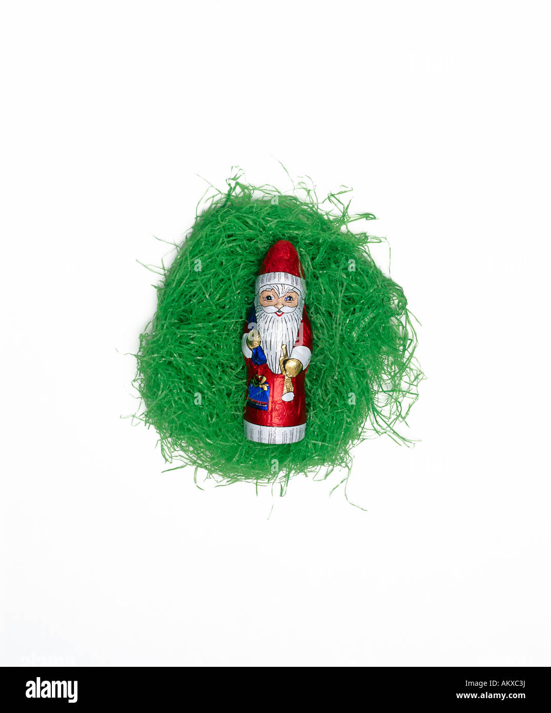 Chocolate Santa Claus lying in an Easter nest Stock Photo