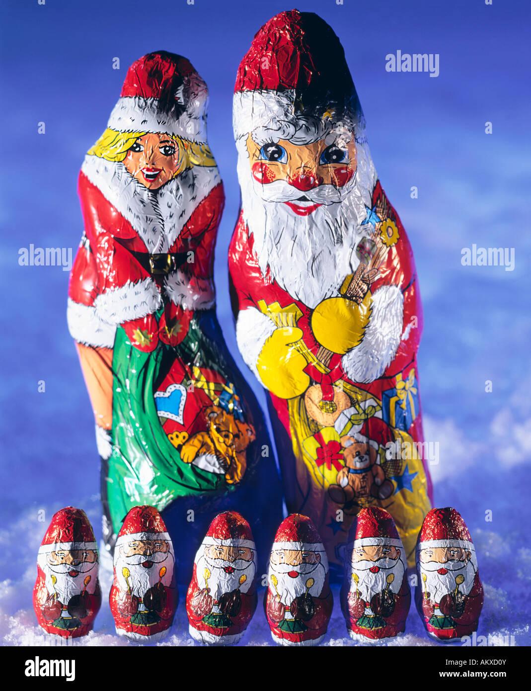 Chocolate Santa Claus, Santa Claus girl and small Santa Clauses Stock Photo