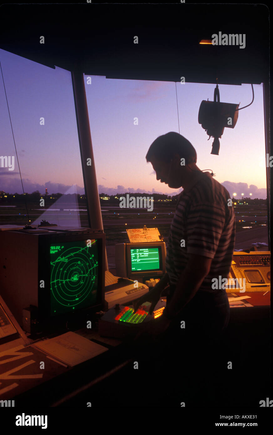 Air traffic controller in control tower - Stock Image