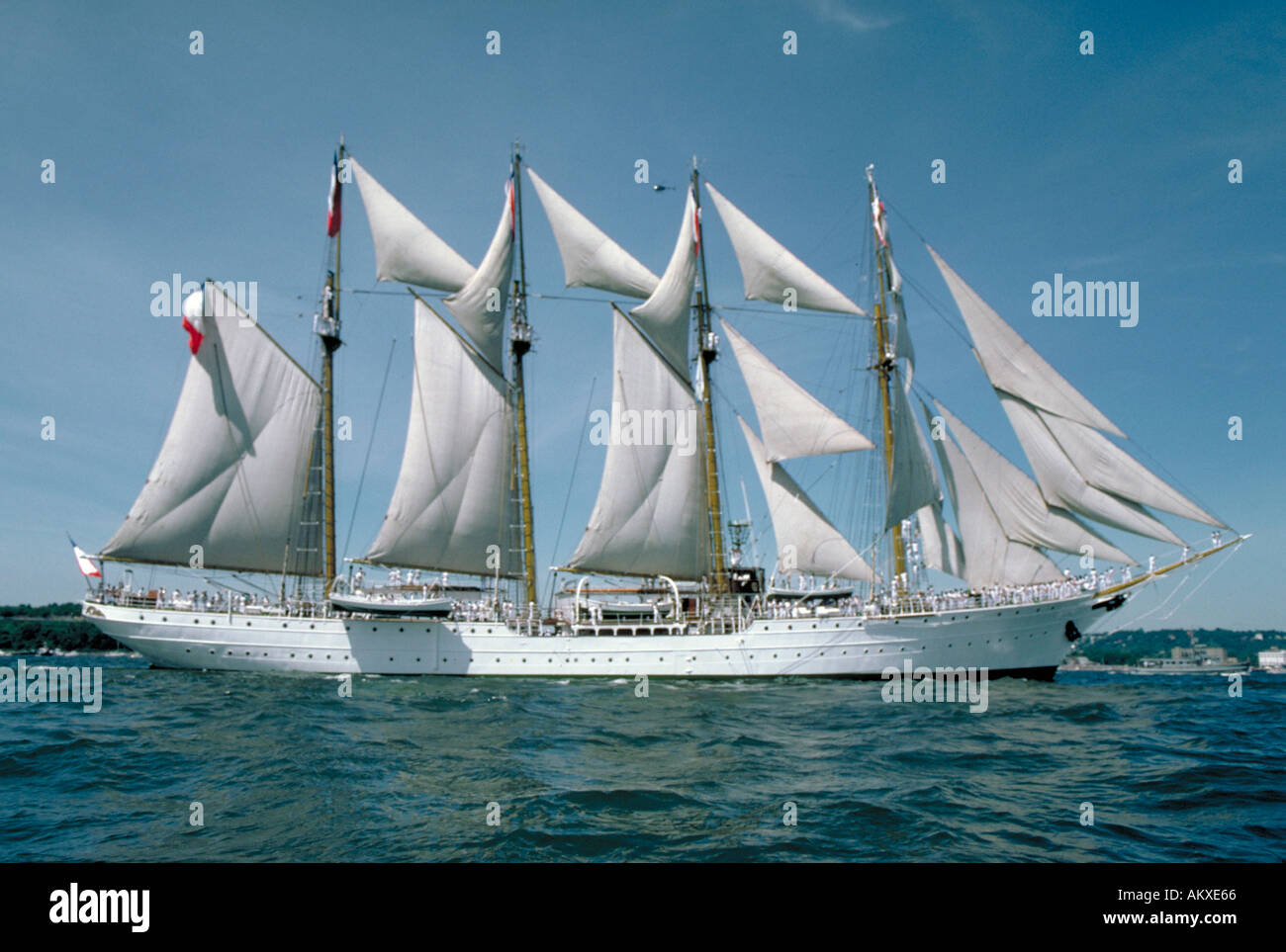 A white four masted barquentine ship at full sail at historic Tall Ships exhibition, Newport Rhode Island - Stock Image