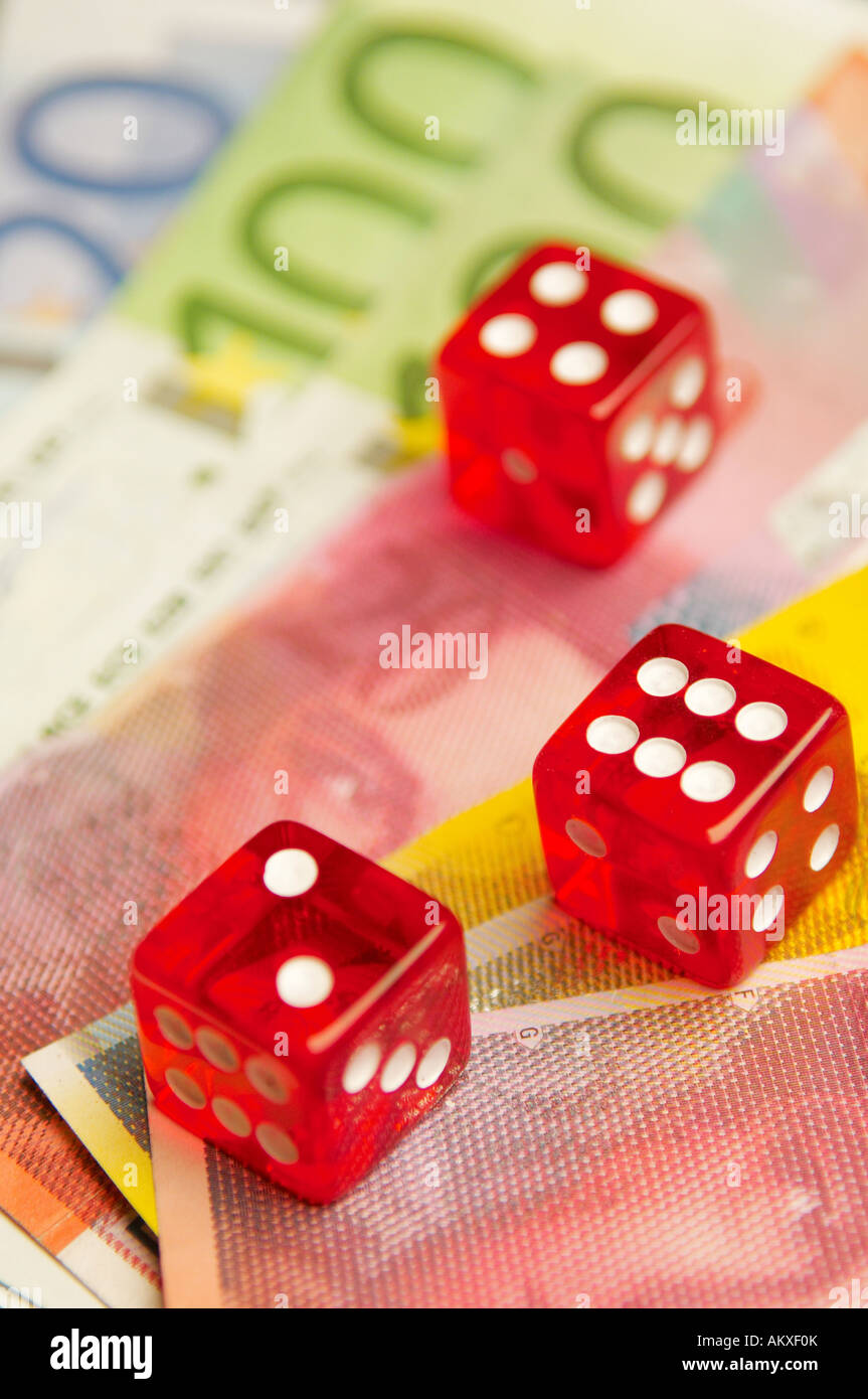 Gambling Dice with Money - Stock Image