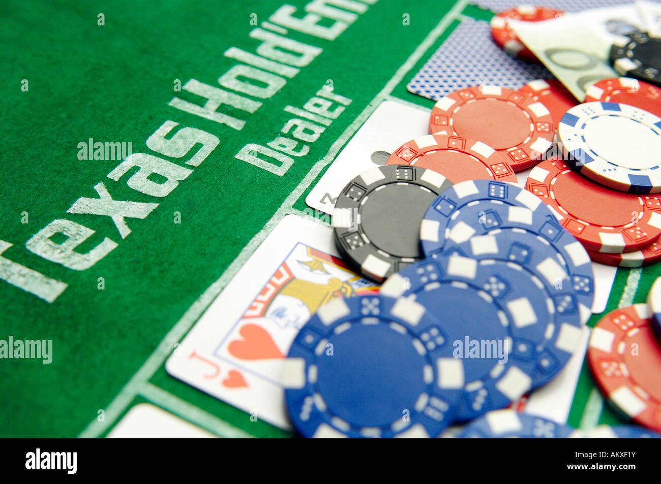 Texas Hold'em Poker Dealer with cards and chips - Stock Image