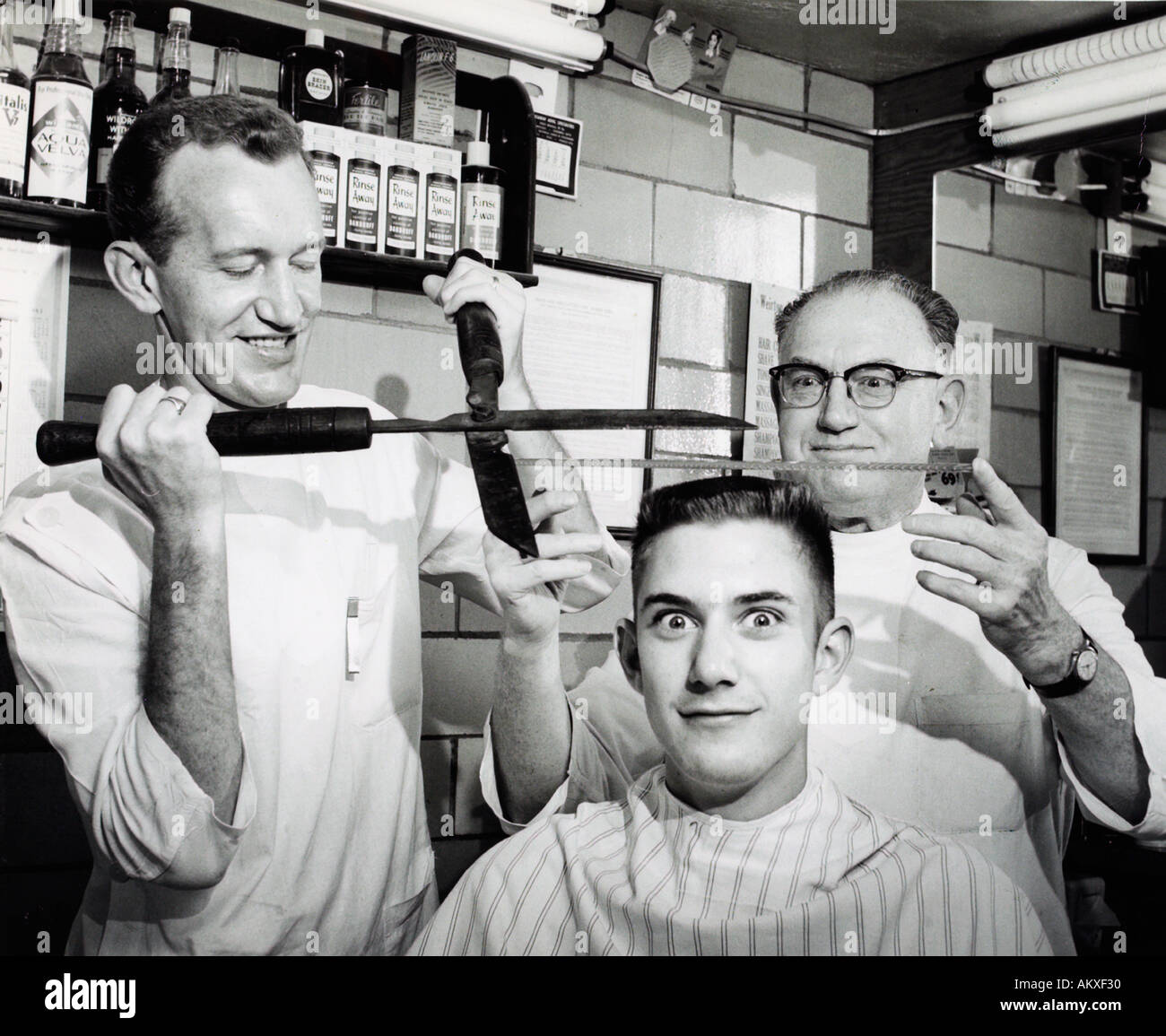 1950u0027s Teenager Getting A Comical Flattop Haircut With Hedge Trimmers At A  Barbershop   Stock Image