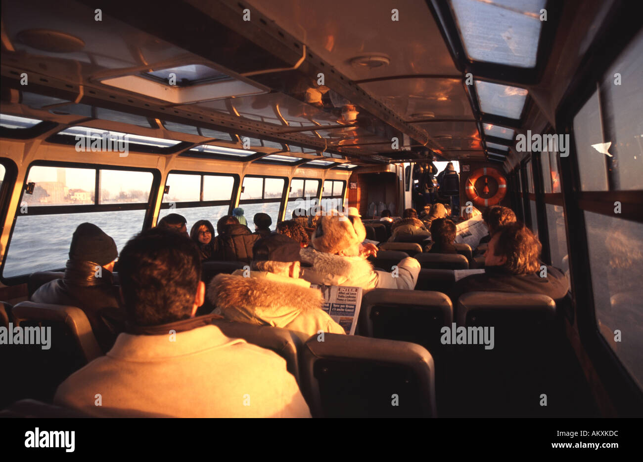 VENICE, ITALY. Early morning commuters on a Venetian vaporetto (water bus). - Stock Image