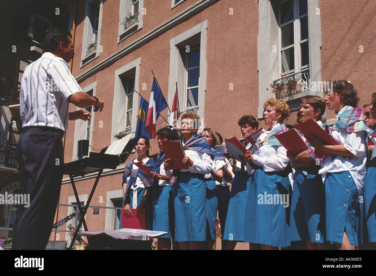In Front Of A Terracotta Coloured Building The Beaufort Choir
