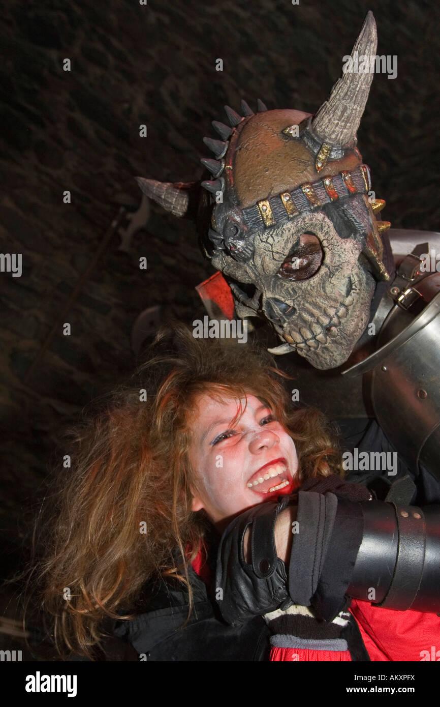 Traditional Halloween spectacle in the castle Frankenstein. A monster frightens a girl, castle Frankenstein, Hessen, - Stock Image