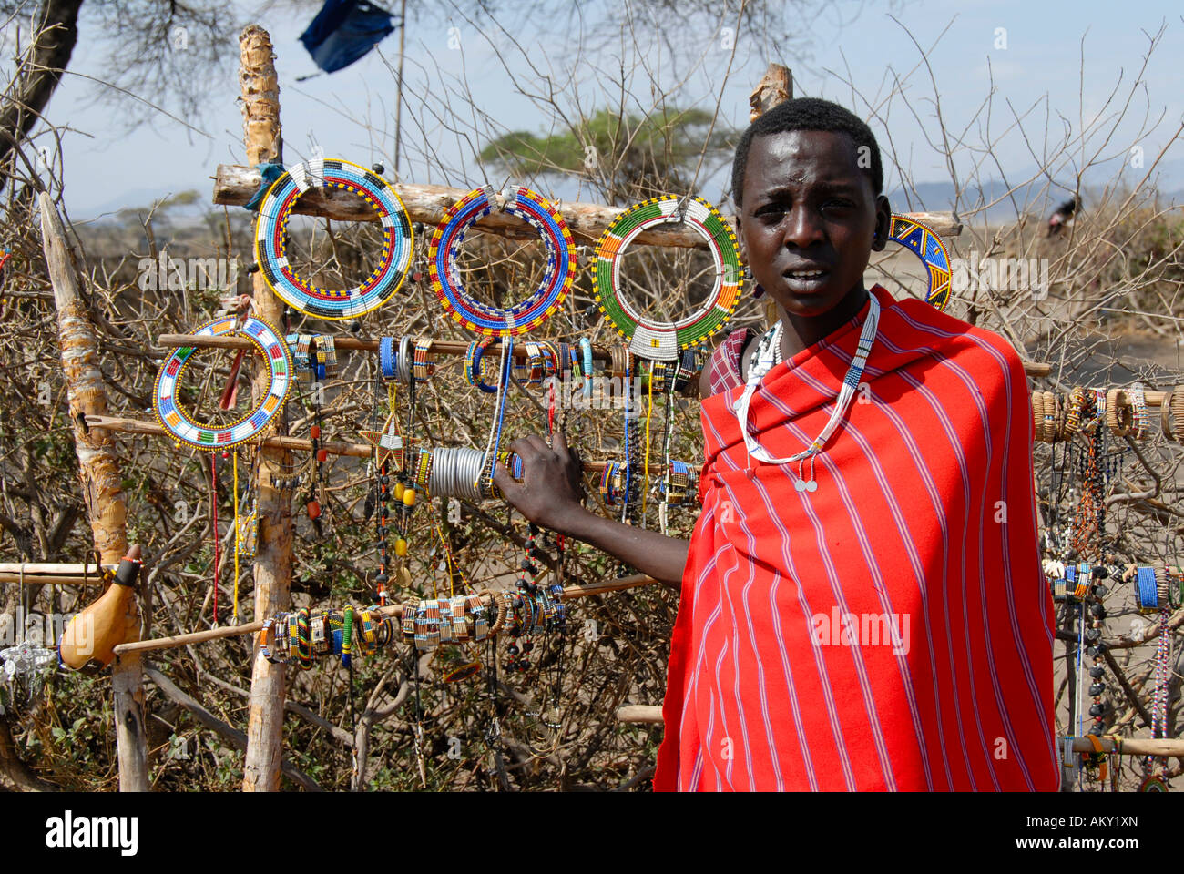 Masai woman sells colourful jewelry in the kraal Ngorongoro Conservation Area Tanzania - Stock Image