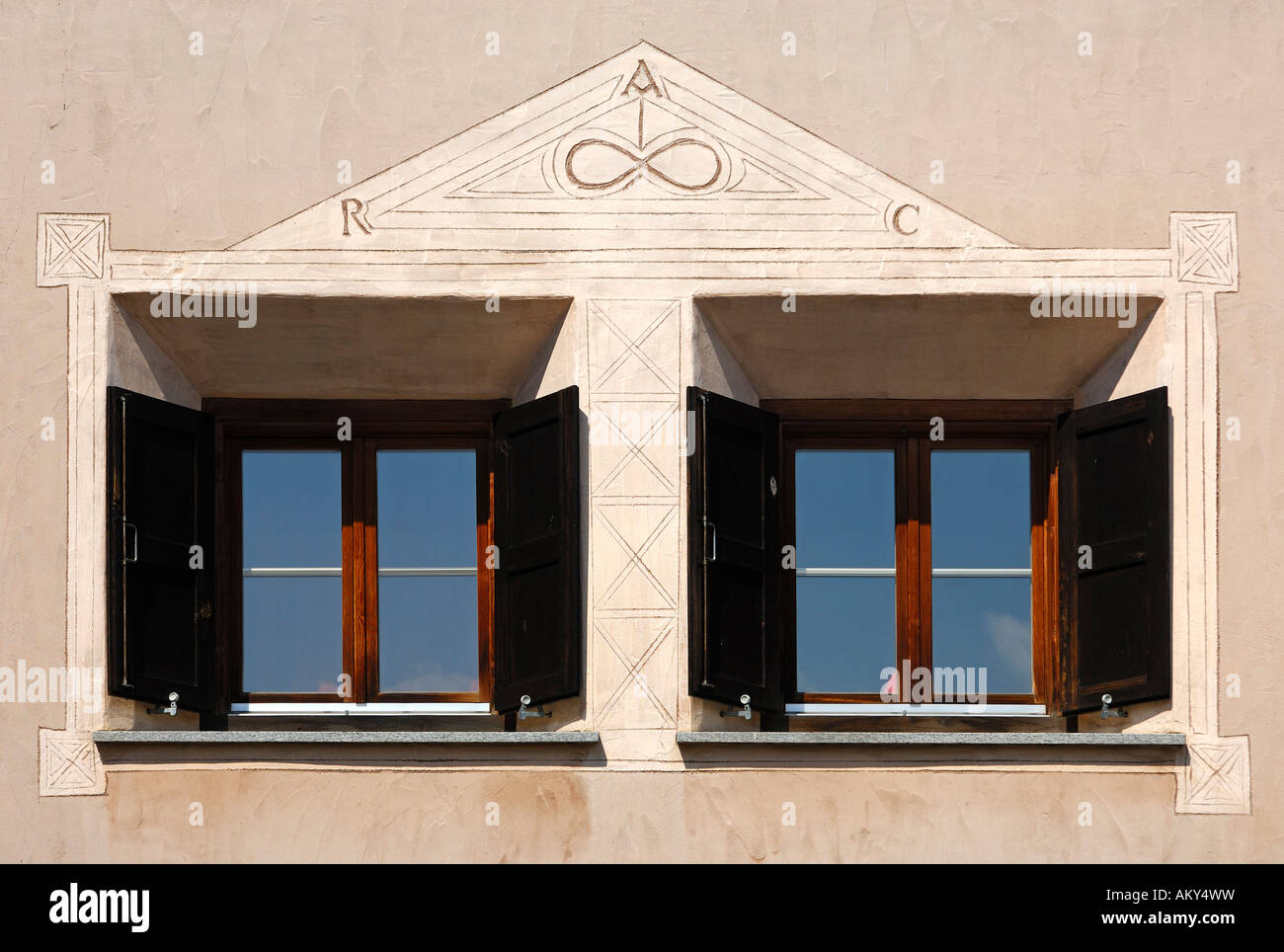 Window view of an Engadine house decorated with Sgraffito ornaments, Samedan, Engadin, Grisons, Switzerland Stock Photo