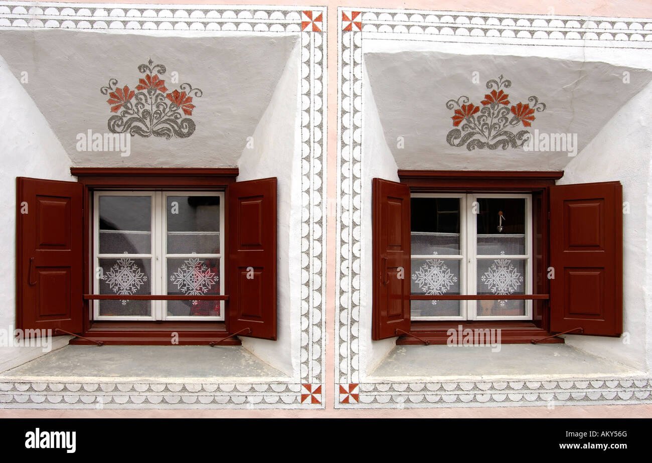 Windows of an Engadin house decorated with Sgraffito ornaments, Scuol, Schuls, Lower Engadin, Grisons, Switzerland Stock Photo