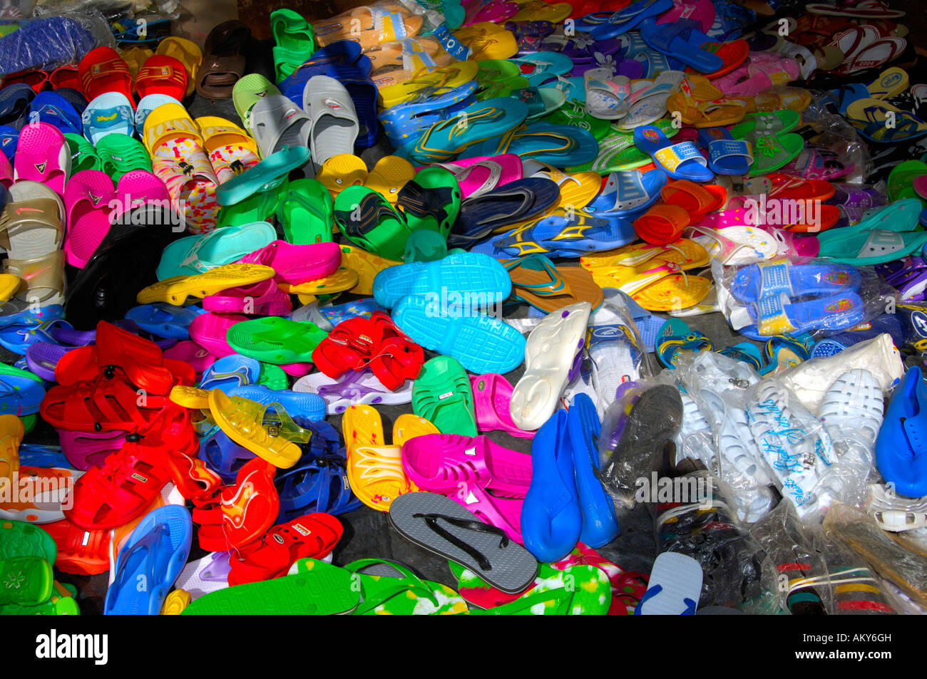 Imported cheap plastic shoes for sale on a local market, Burkina Faso - Stock Image