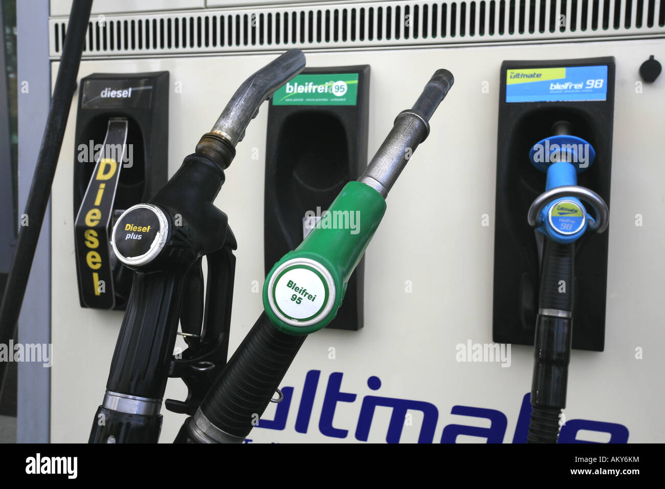 Fuel nozzles at a gas station with Diesel and Unleaded Fuel - Stock Image